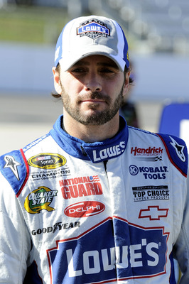 MARTINSVILLE, VA - OCTOBER 22:  Jimmie Johnson, driver of the #48 Lowe's Chevrolet, walks on pit road during qualifying for the NASCAR Sprint Cup Series TUMS Fast Relief 500 at Martinsville Speedway on October 22, 2010 in Martinsville, Virginia.  (Photo b