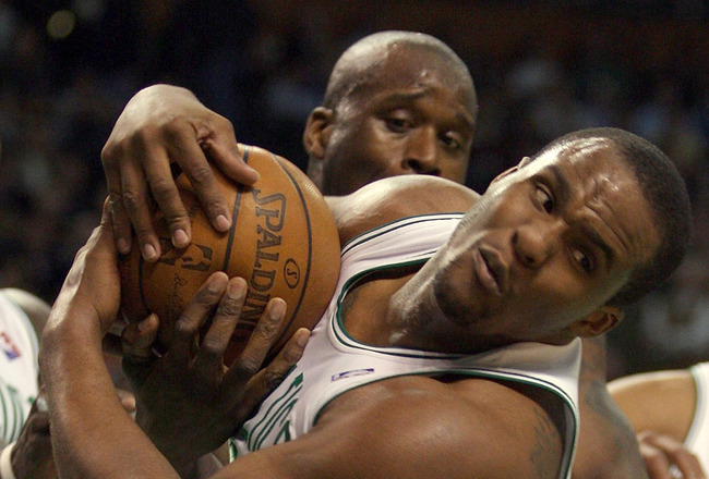 BOSTON - MARCH 26:  Glen Davis #11 of the Boston Celtics grabs the rebound from Shaquille O'Neal #32  of the Phoenix Suns on March 26, 2008 at the TD Banknorth Garden in Boston, Massachusetts. The Celtics defeated the Suns 117-97. NOTE TO USER: User expre