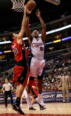 LOS ANGELES - DECEMBER 18:  Corey Maggette #50 of the Los Angeles Clippers makes a basket over Carlos Delfino #20 of the Toronto Raptors on December 18, 2007 at Staples Center in Los Angeles, California.  The Raptors won 80-77. NOTE TO USER: User expressl