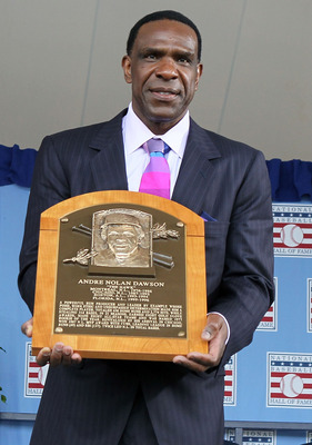 COOPERSTOWN, NY - JULY 25:  2010 inductee Andre Dawson poses for a photograph with his plaque at Clark Sports Center during the Baseball Hall of Fame induction ceremony on July 25, 20010 in Cooperstown, New York. Dawson was an eight time all-star during h