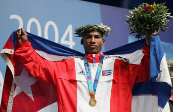 ATHENS - AUGUST 28:  Yuriorkis Gamboa Toledano of Cuba, Gold medalist in the men's boxing 51 kg event on August 28, 2004 during the Athens 2004 Summer Olympic Games at Peristeri Olympic Boxing Hall in Athens, Greece. (Photo by Al Bello/Getty Images)
