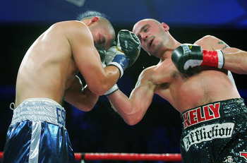 YOUNGSTOWN, OH - DECEMBER 19:  Kelly Pavlik (R) fights against Miguel Espino during their match at the Beeghly Center on December 19, 2009 in Youngstown, Ohio.  (Photo by Jared Wickerham/Getty Images)