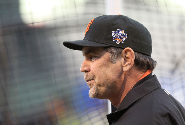 SAN FRANCISCO - OCTOBER 26:  Manager Bruce Bochy of the San Francisco Giants watches his team during a workout session at AT&T Park on October 26, 2010 in San Francisco, California. The Texas Rangers will face off against the San Francisco Giants in Game