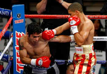 LAS VEGAS - DECEMBER 06:  (R-L) Juan Manuel Lopez of Puerto Rico connects a right to the head of Sergio Medina of Argentina during their WBO junior featherweight title fight at the MGM Grand Garden Arena December 6, 2008 in Las Vegas, Nevada.  (Photo by E