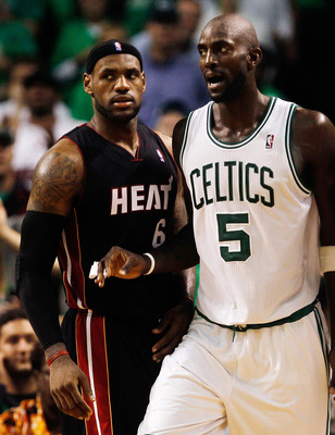 BOSTON, MA - OCTOBER 26:  Kevin Garnett #5 of the Boston Celticsof the Boston Celtics defends against LeBron James #6 of the Miami Heat at the TD Banknorth Garden on October 26, 2010 in Boston, Massachusetts. NOTE TO USER: User expressly acknowledges and