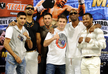 LAS VEGAS - JULY 30:  (L-R) Boxers Amir Khan, David Haye, Oscar De La Hoya, Michael Katsidis, Bernard Hopkins and Shane Mosley appear during the official weigh-in for WBA/WBO lightweight champion Juan Manuel Marquez and Juan Diaz at the Mandalay Bay Event