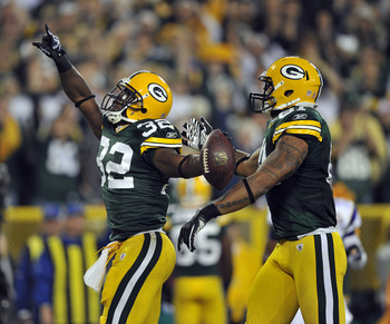 GREEN BAY, WI - OCTOBER 24:  Brandon Jackson #32 of the Green Bay Packers celebrates at touchdown with teammate Andrew Quarless #81 against the Minnesota Vikings at  Lambeau Field on October 24, 2010 in Green Bay, Wisconsin. (Photo by Jim Prisching/Getty