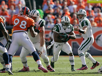 DENVER - OCTOBER 17:  Running back Shonn Greene #23 the New York Jets looks for a hole against the Denver Broncos at INVESCO Field at Mile High on October 17, 2010 in Denver, Colorado.  (Photo by Justin Edmonds/Getty Images)