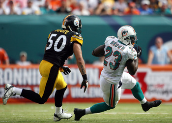 MIAMI - OCTOBER 24:  Running back Ronnie Brown #23 eludes linebacker Larry Foote #50 of the Pittsburgh Steelers  at Sun Life Stadium on October 24, 2010 in Miami, Florida.  (Photo by Marc Serota/Getty Images)