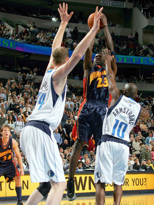 DALLAS - DECEMBER 14: Guard Jason Richardson #23 of the Golden State Warriors takes a shot against Shawn Bradley #44 and Darrell Armstrong #10 of the Dallas Mavericks on December 14, 2004 at the American Airlines Center in Dallas, Texas.   (Photo by Ronal