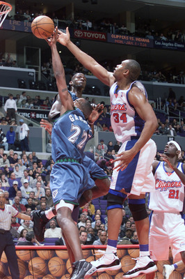 20 Dec 2000:  Dean Garrett #22 of the Minnesota Timberwolves blocks an offensive rebound by Michael Olowakandi #34 of the Los Angeles Clippersat the Staples Center in Los Angeles, California.  The Clippers defeated the Timberwolves 103-96.   DIGITAL IMAGE
