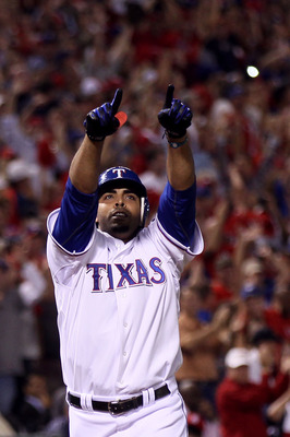 ARLINGTON, TX - OCTOBER 22:  Nelson Cruz #17 of the Texas Rangers celebrates as he crosses home plate and score on his 2-run home run in the bottom of the fifth inning against the New York Yankees in Game Six of the ALCS during the 2010 MLB Playoffs at Ra