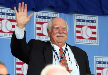 COOPERSTOWN, NY - JULY 26:  Hall of Famer Gaylord Perry waves to the crowd as he is introduced at Clark Sports Center during the 2009  Baseball Hall of Fame induction ceremony on July 26, 2009 in Cooperstown, New York.  (Photo by Jim McIsaac/Getty Images)