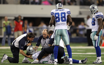 ARLINGTON, TX - OCTOBER 25:  Quarterback Tony Romo #9 of the Dallas Cowboys lies on the field after a left shoulder injury in the second quarter against the New York Giants at Cowboys Stadium on October 25, 2010 in Arlington, Texas.  (Photo by Ronald Mart