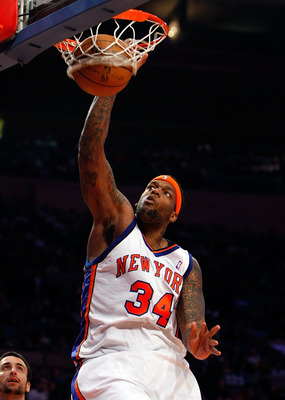 NEW YORK - FEBRUARY 08:  Eddy Curry #34 of the New York Knicks dunks the ball against the San Antonio Spurs on February 8, 2008 at Madison Square Garden in New York City. NOTE TO USER: User expressly acknowledges and agrees that, by downloading and/or usi