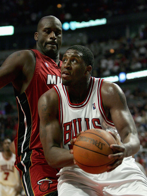 CHICAGO - APRIL 30:   Michael Sweetney #50 of the Chicago Bulls moves past Shaquille O'Neal #32 of the Miami Heat in game four of the Eastern Conference Quarterfinals during the 2006 NBA Playoffs at the United Center on April 30, 2006 in Chicago, Illinois