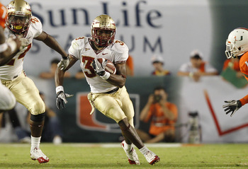 MIAMI, FL - OCTOBER 9: Jermaine Thomas #38 of the Florida State Seminoles runs with the ball against the Miami Hurricanes on October 9, 2010 at Sun Life Stadium in Miami, Florida. (Photo by Joel Auerbach/Getty Images)