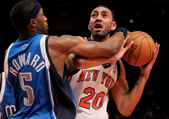 NEW YORK - JANUARY 24: Jared Jeffries #20 of the New York Knicks holds the ball away from Josh Howard #5 of the Dallas Mavericks at Madison Square Garden January 24, 2010 in New York City. NOTE TO USER: User expressly acknowledges and agrees that, by down