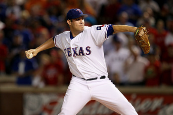ARLINGTON, TX - OCTOBER 22:  Starting pitcher Colby Lewis #48 of the Texas Rangers pitches against the New York Yankees in the first inning of Game Six of the ALCS during the 2010 MLB Playoffs at Rangers Ballpark in Arlington on October 22, 2010 in Arling