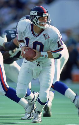 31 Oct 1999: Kent Graham #10 of the New York Giants moves to pass the ball during the game against the Philadelphia Eagles at the Veteran Stadium in Philadelphia, Pennsylvania. The Giants defeated the Eagles 23-17. Mandatory Credit: Ezra O. Shaw  /Allspor