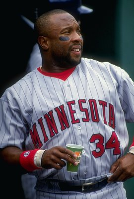 26 May 1993:  Kirby Puckett #34 of the Minnesota Twins looks on from the dugout during a game against the Oakland Athletics at the Oakland Coliseum in Oakland, California. Mandatory Credit: Otto Greule Jr.  /Allsport