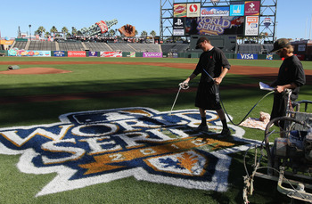 SAN FRANCISCO - OCTOBER 26:  Workers paint the World Series logo onto the field before the start of team workouts at AT&T Park on October 26, 2010 in San Francisco, California.  The San Francisco Giants will face the Texas Rangers in the first game of the
