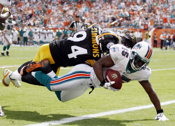 MIAMI - OCTOBER 24:  Receiver Davone Bess #15 scores a touchdown against linebacker Lawrence Timmons #94 of the Pittsburgh Steelers  at Sun Life Stadium on October 24, 2010 in Miami, Florida.  (Photo by Marc Serota/Getty Images)