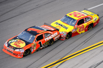 TALLADEGA, AL - APRIL 25:  Kevin Harvick, driver of the #29 Shell/Pennzoil Chevrolet, bump drafts Jamie McMurray, driver of the #1 Bass Pro Shops Chevrolet, during the NASCAR Sprint Cup Series Aaron's 499 at Talladega Superspeedway on April 25, 2010 in Ta
