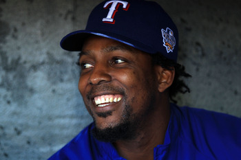 SAN FRANCISCO - OCTOBER 26:  Vladimir Guerrero #27 of the Texas Rangers smiles while sittting in the dugout during a workout session at AT&T Park on October 26, 2010 in San Francisco, California. The Texas Rangers will face off against the San Francisco G