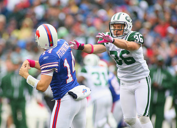 ORCHARD PARK, NY - OCTOBER 03: Ryan Fitzpatrick #14  of the Buffalo Bills gets a pass off with pressure from Jim Leonard #36 of the New York Jets   at Ralph Wilson Stadium on October 3, 2010 in Orchard Park, New York. The Jets won 38-14. (Photo by Rick St