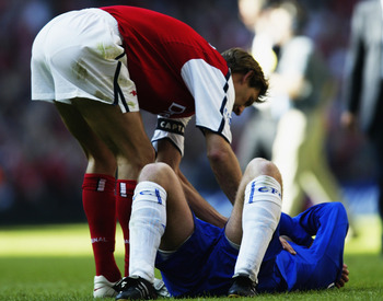 4 May 2002:  Tony Adams of Arsenal consoles Eidur Gudjohnsen of Chelsea after the AXA sponsored FA Cup Final played at the Millennium Stadium, in Cardiff, Wales. Arsenal won the match and cup 2-0. DIGITAL IMAGE. (Photo by Michael Steele/Getty Images)