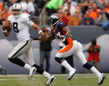 DENVER - OCTOBER 24:  Quarterback Jason Campbell #8 of the Oakland Raiders tries to elude cornerback Nate Jones #33 of the Denver Broncos in the first quarter at INVESCO Field at Mile High on October 24, 2010 in Denver, Colorado. (Photo by Justin Edmonds/