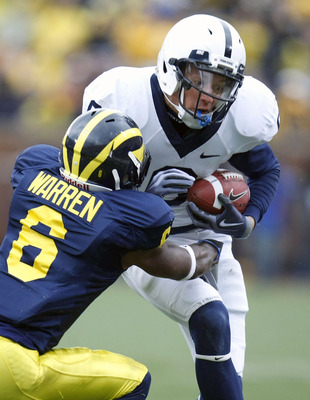 ANN ARBOR, MI - OCTOBER 24:  Derek Moye #6 of the Penn State Nittany Lions is takled by Donovan Warren #6 of the Michigan Wolverines on October 24, 2009 at Michigan Stadium in Ann Arbor, Michigan. Penn State won the game 35-10. (Photo by Gregory Shamus/Ge