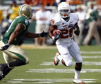 WACO, TX - NOVEMBER 14:  Running back Fozzy Whittaker #28 of the Texas Longhorns carries the ball in the first half against Byron Landon #14 of the Baylor Bears on November 14, 2009 at Floyd Casey Stadium in Waco, Texas.   The Longhorns beat the Bears 47-