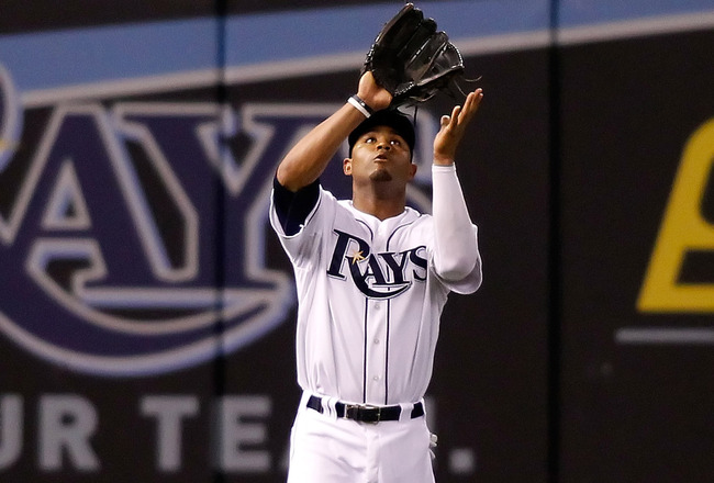 ST. PETERSBURG, FL - SEPTEMBER 15:  Outfielder Carl Crawford #13 of the Tampa Bay Rays catches a fly ball against the New York Yankees during the game at Tropicana Field on September 15, 2010 in St. Petersburg, Florida.  (Photo by J. Meric/Getty Images)