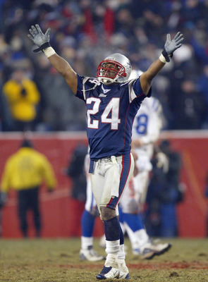 FOXBORO, MA - JANUARY 18:  Cornerback Ty Law #24 of the New England Patriots celebrates against the Indianapolis Colts in the AFC Championship Game on January 18, 2004 at Gillette Stadium in Foxboro, Massachusetts. The Patriots defeated the Colts 24-14 to