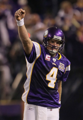 MINNEAPOLIS - OCTOBER 17:  Quarterback Brett Favre #4 of the Minnesota Vikings celebrates a pass interference call against Mike Jenkins (not pictured) of the Dallas Cowboys during the fourth quarter at Mall of America Field on October 17, 2010 in Minneapo