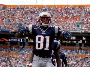MIAMI, FL - OCTOBER 21: Wide receiver Randy Moss #81 of the New England Patriots celebrates a touchdown against the Miami Dolphins October 21, 2007 at Dolphin Stadium in Miami, Florida. (Photo by Al Messerschmidt/Getty Images)