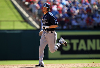 ARLINGTON, TX - OCTOBER 10:  Evan Longoria #3 of the Tampa Bay Rays runs after hitting a two run homerun against the Texas Rangers in the 5th inning during game 4 of the ALDS at Rangers Ballpark in Arlington on October 10, 2010 in Arlington, Texas.  (Phot