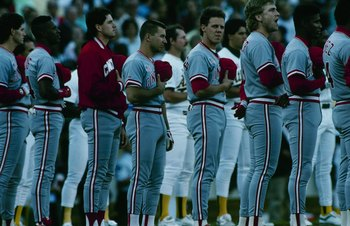 OAKLAND - OCTOBER 1990:  Cincinnati Reds players stand for the National Anthem before a 1990 World Series game against the Oakland Athletics at Oakland Coliseum in October 1990 in Oakland, California. (Photo by Otto Greule Jr/Getty Images)