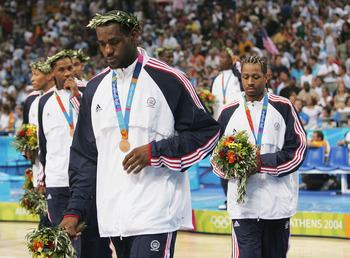 ATHENS - AUGUST 28:  LeBron James #9, Carmelo Anthony #8 and Allen Iverson of the United States walk off the court after they receive the bronze medal for men's basketball during ceremonies on August 28, 2004 during the Athens 2004 Summer Olympic Games at