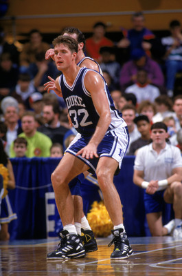 DECEMBER 7:  Christian Laettner #32 of the Duke University Blue Devils battles for position during an NCAA game against Canisius College on December 7, 1991 at the Koessler Athletic Center in Buffalo, New York.  Duke defeated Canisius 96-60.  (Photo by Ri