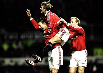 26 Dec 1998:  Ronny Johnsen of Manchester United is congratulated by team mates David Beckham and Henning Berg after scoring against Nottingham Forest in the FA Carling Premiership match at Old Trafford in Manchester, England. United won 3-0. \ MandatoryC