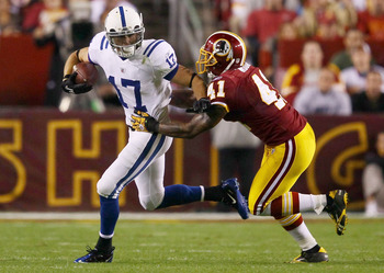 LANDOVER, MD - OCTOBER 17: Austin Collie #17 of the Indianapolis Colts moves the ball upfield after making a reception against Kareem Moore #41 of the Washington Redskins at FedExField on October 17, 2010 in Landover, Maryland.  (Photo by Win McNamee/Gett