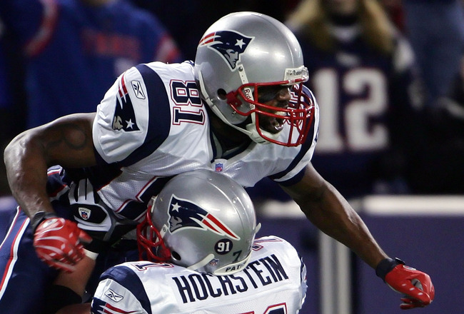 EAST RUTHERFORD, NJ - DECEMBER 29:  Randy Moss  #81 of the New England Patriots celebrates his 22nd touchdown of the season tying the all-time season high for touchdowns in a season with teammate Russ Hochstein #71 against the New York Giants on December