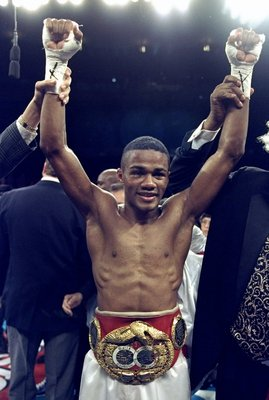 20 Feb 1999:  Felix Trinidad celebrates as he wears the belt after the fight against Pernell Whitaker at Madison Square Garden in New York, New York. Trinidad won by a decision in the 12th round. Mandatory Credit: Al Bello  /Allsport