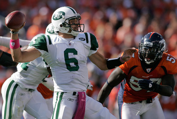 DENVER - OCTOBER 17:  Quarterback Mark Sanchez #6 the New York Jets makes a pass as linebacker Mario Haggan #57 of the Denver Broncos gives chase at INVESCO Field at Mile High on October 17, 2010 in Denver, Colorado.  (Photo by Justin Edmonds/Getty Images