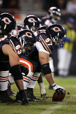 CHICAGO - DECEMBER 31:  Center Olin Kreutz #57 of the Chicago Bears readies to snap the ball against the Green Bay Packers December 31, 2006 at Soldier Field in Chicago, Illinois. The Packers won 26-7. (Photo by Jonathan Daniel/Getty Images)