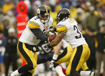 ORCHARD PARK, NY - JANUARY 2: Quarterback Brian St. Pierre #2 of the Pittsburgh Steelers hands off to Willie Parker #39 against the Buffalo Bills January 2, 2004 at Ralph Wilson Stadium in Orchard Park, New York. The Steelers defeated the Bills 29-24, to