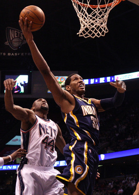 EAST RUTHERFORD, NJ - JANUARY 15:  Danny Granger #33 of the Indiana Pacers drives to the hoop for a basket against Trenton Hassell #44 of the New Jersey Nets at the Izod Center on January 15, 2010 in East Rutherford, New Jersey. NOTE TO USER: User express